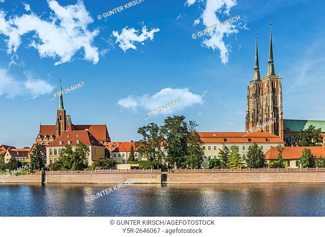 View over the river Oder to. the Cathedral Island (Ostrow Tumski). On the Cathedral Island are the Cross Church (left) and the Wroclaw Cathedral (right)