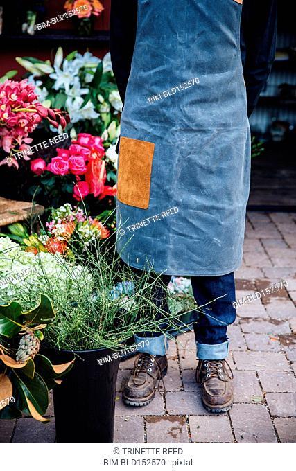 Close up of Caucasian florist standing outside shop