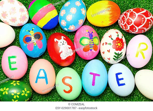 Top view of easter eggs on green grass background