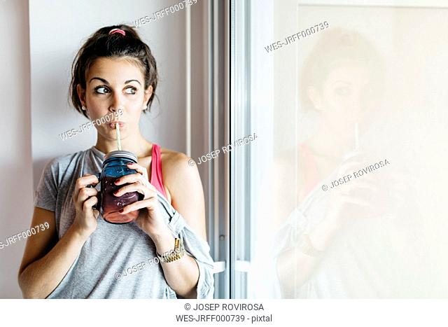Young woman drinking healthy drink