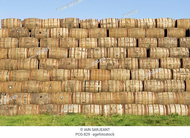 Pile of whisky barrels outside a warehouse near Alloa, Clackmannanshire, Scotland, UK