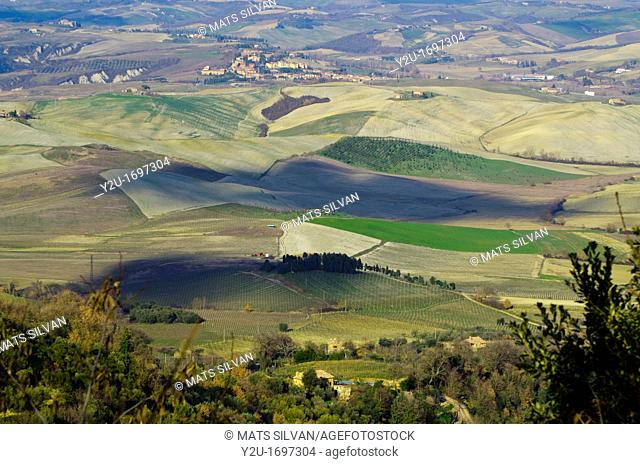 Panorama view over the field with shadows from the clouds in tuscany italy
