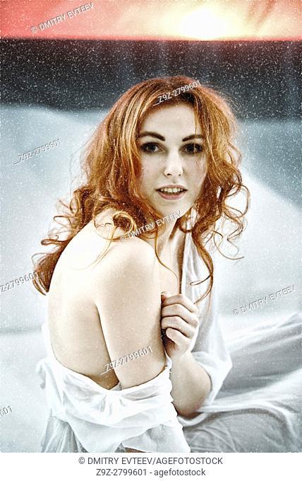 Redhair maiden portrait at unreal snow landscape