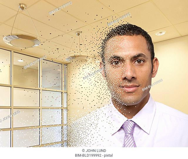Mixed race businessman with pixilated face