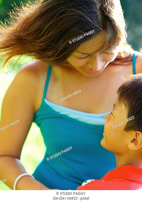 Mid adult woman standing with her son and smiling
