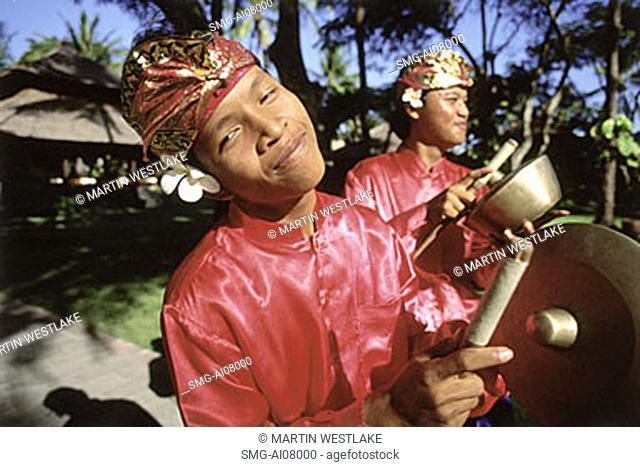 Indonesia, Bali, Kuta, Smiling gamelan players in hotel grounds. (grainy)