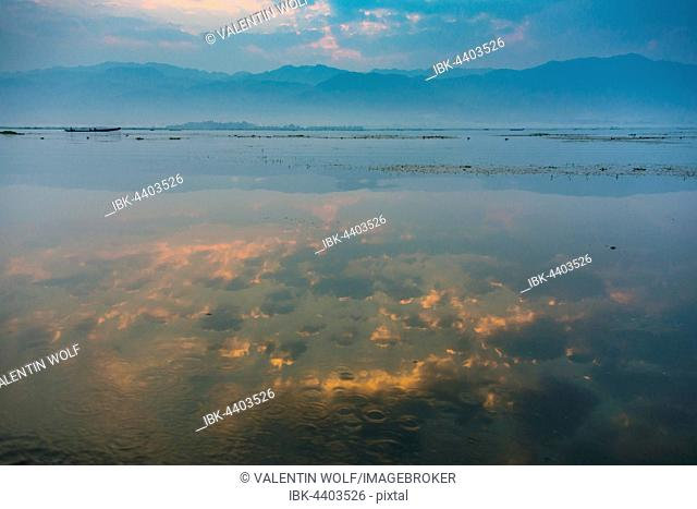 Sunrise and water reflection at Inle Lake, Shan State, Myanmar