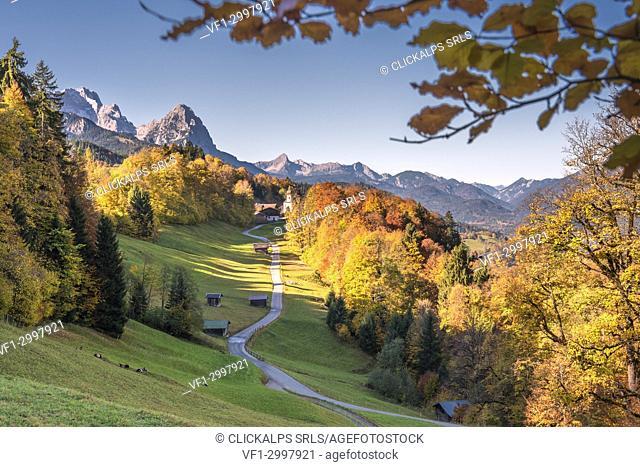 Wamberg, Garmisch-Partenkirchen, Bavaria, Germany. The little Wamberg village with the Mount Zugspitze and the Mount Waxenstein