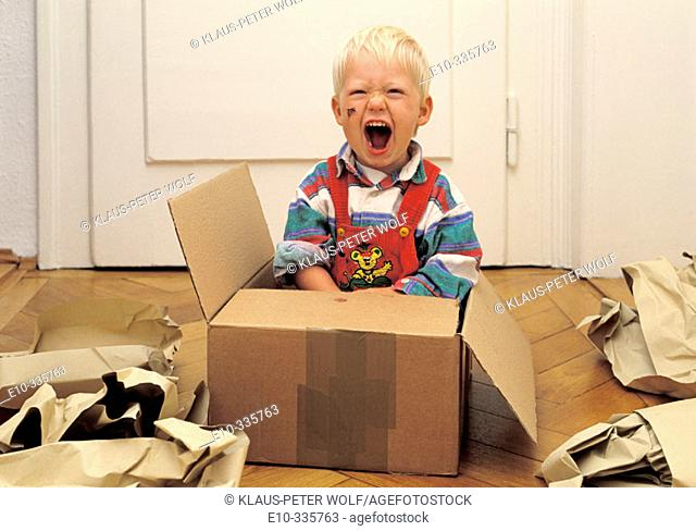2 year old boy in a box crying