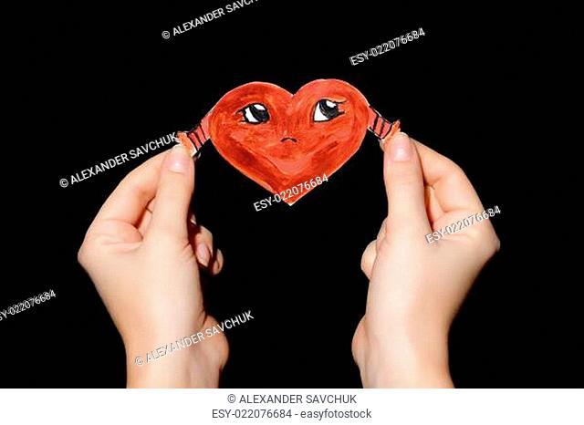 Smiling heart in hands