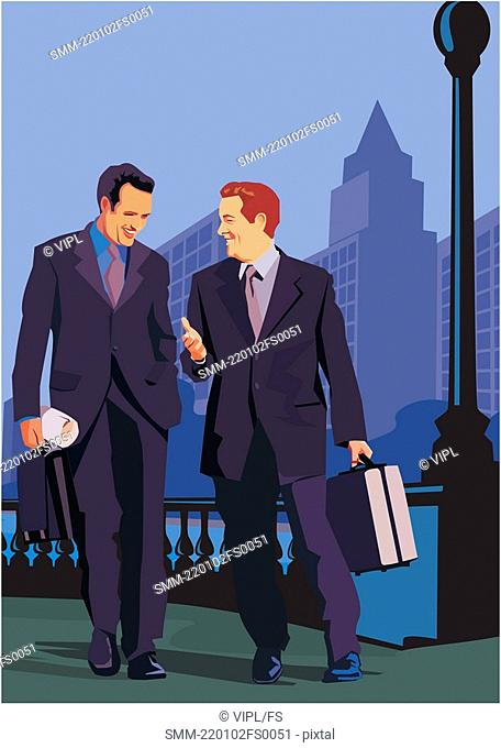 Front view of businessmen walking on road