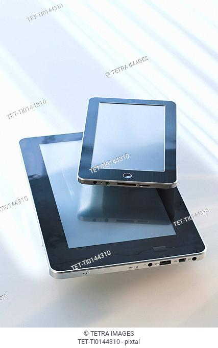 Two digital tablets reflecting light
