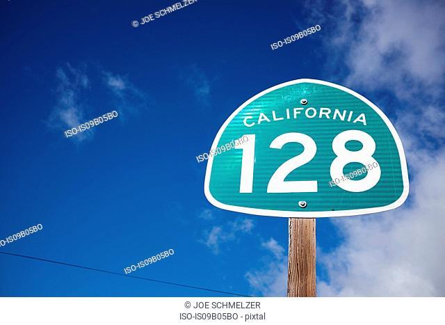 California 128 highway sign against blue sky, California, USA