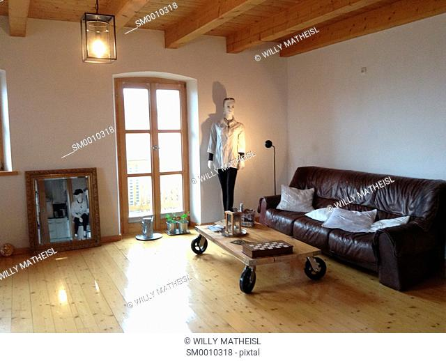 modern Living room with wood beam ceiling and wooden floor