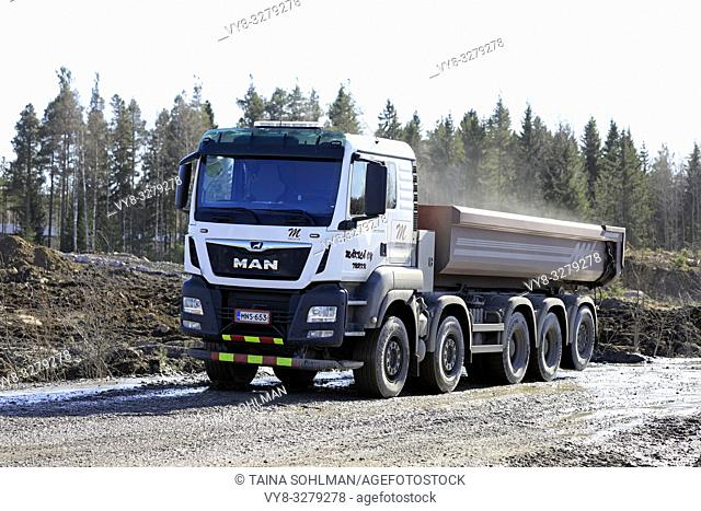 Lieto, Finland - March 22, 2019: White MAN TGS 45. 500 tipper truck of Makila Oy at work on a construction site on a sunny day of spring
