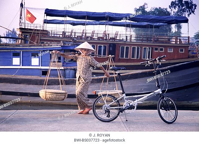 harbour scenery, native looking after modern bike, Vietnam, Hoi An