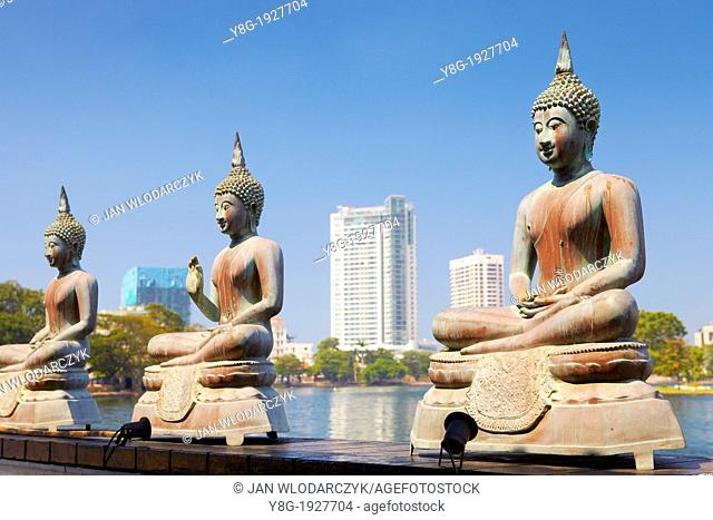 Sri Lanka - Capital City Colombo, Buddha Statues in Seema Malaka Temple on Beira Lake, 'World Trade Center' in the background , Sri Lanka, Asia