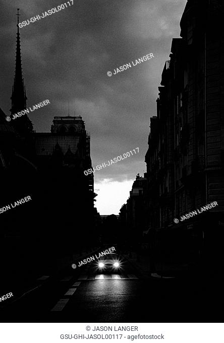 Lone Car on Narrow Street at Night, Paris, France