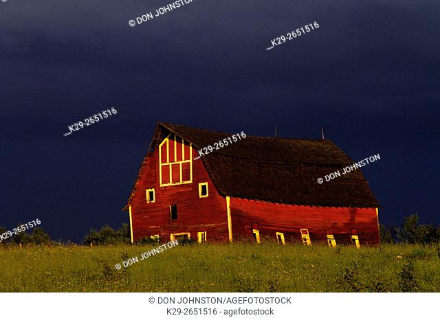 Red barn and receding thunderstorm, Duluth, Wisconsin, USA