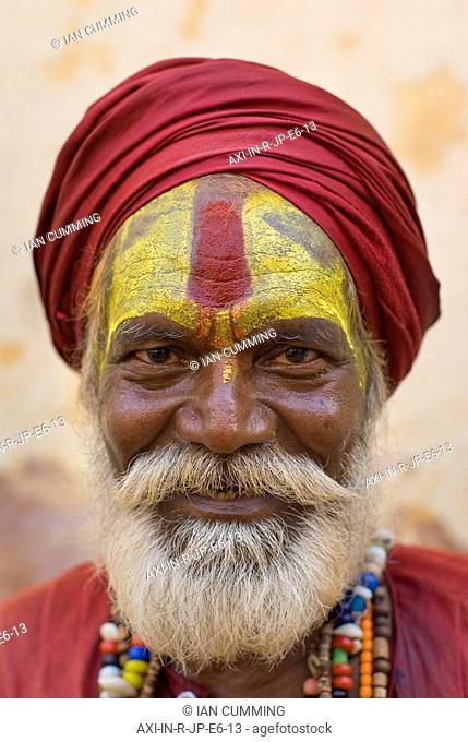 Portrait of sadhu in red turban and beard