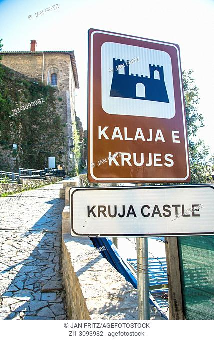 sign with Kruje castle at Kruje, Albania