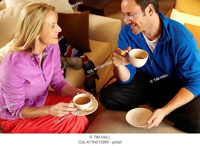 Couple having cup of coffee together