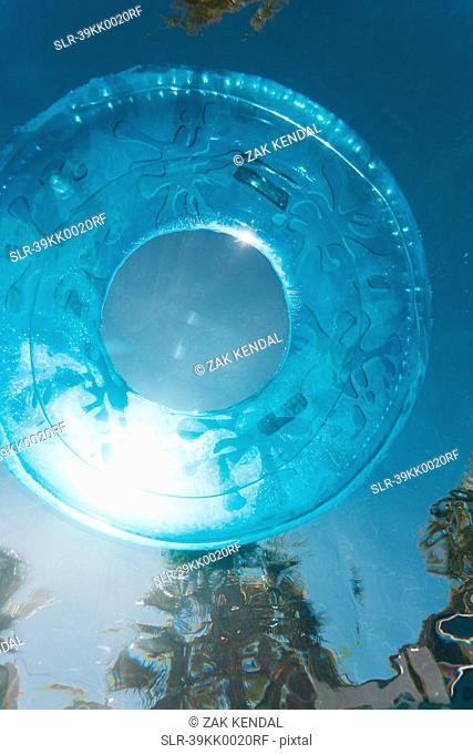 Inner tube floating in swimming pool