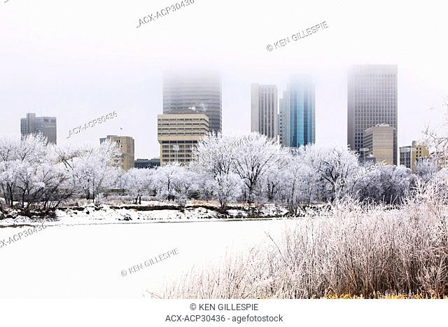 Downtown Winnipeg skyline and frozen Red River on a frosty winter day. Winnipeg, Manitoba, Canada
