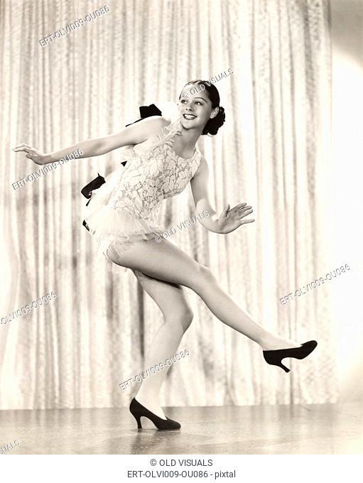 Dancer kicking up her heels on stage