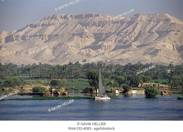 Felucca on the River Nile, looking towards Valley of the Kings, Luxor, Thebes, Egypt, North Africa, Africa