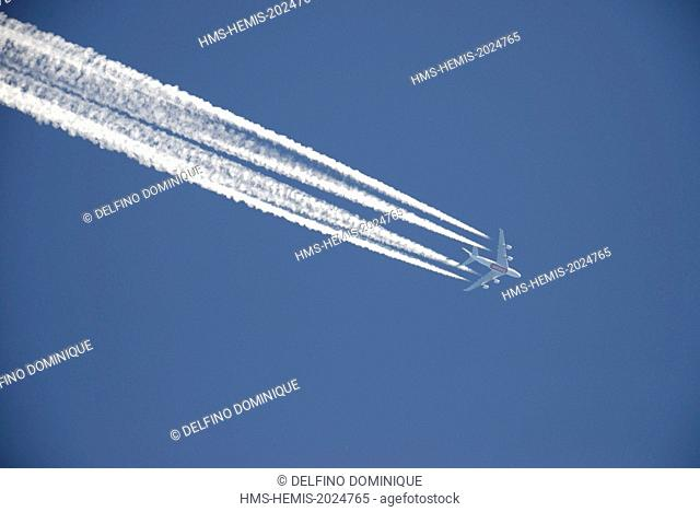 France, Doubs, long haul aircraft with four engines in the open blue sky leaving a white trail behind him important