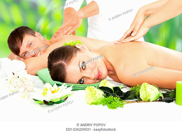 Attractive Couple Lying Side By Side Enjoying Spa Treatment
