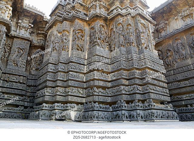 View of ornate wall panel relief in a stellate form of shrine, Hoysaleshwara temple, Halebidu, Karnataka, india. View from South West