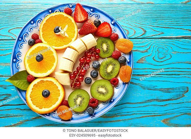 Fruit salad breakfast orange banana kiwi berries ow turquoise table