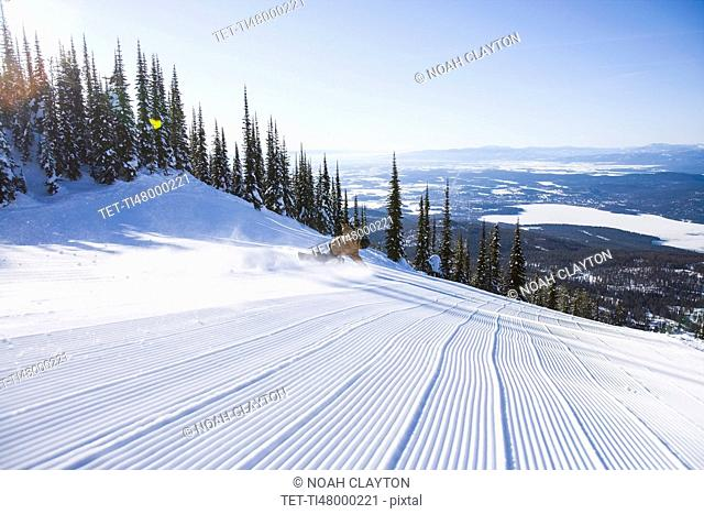 Snowboarder on side of ski slope