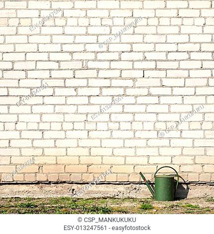 watering can near the wall