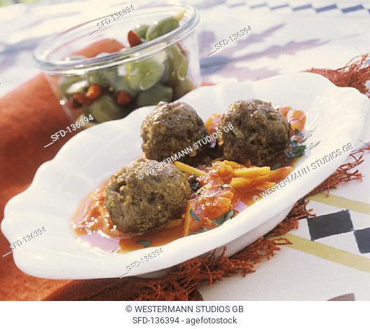 Meatballs on tomato & carrot sauce and bottled olives