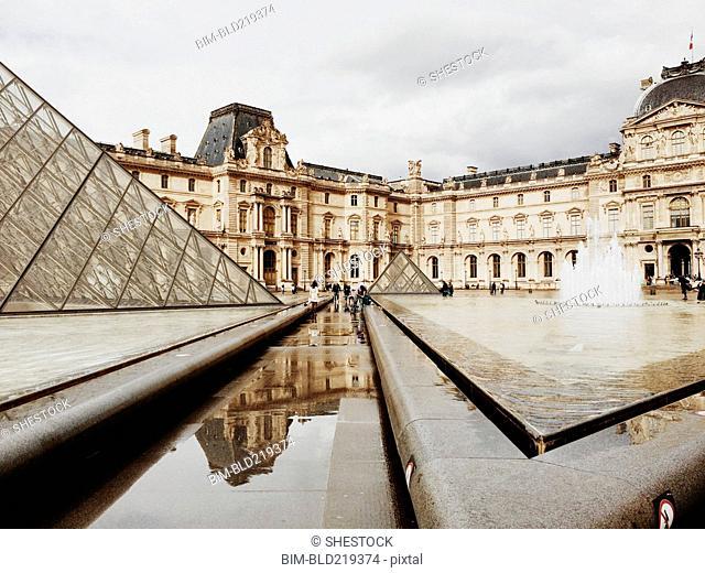 Louvre pyramid and ornate buildings, Paris, Ile-de-France, France