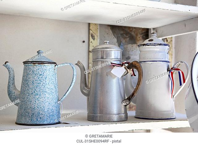 Old emaile Coffecans on a shelf