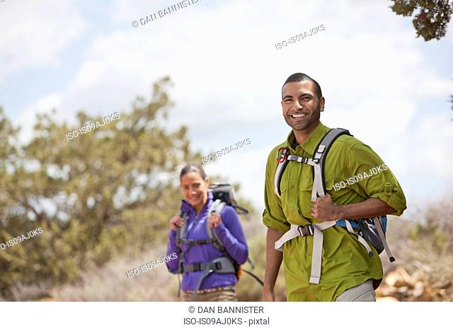 Portrait of young man and his girlfriend hiking, Sedona, Arizona, USA
