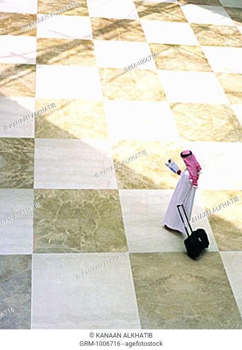 Arab businessman reading newspaper