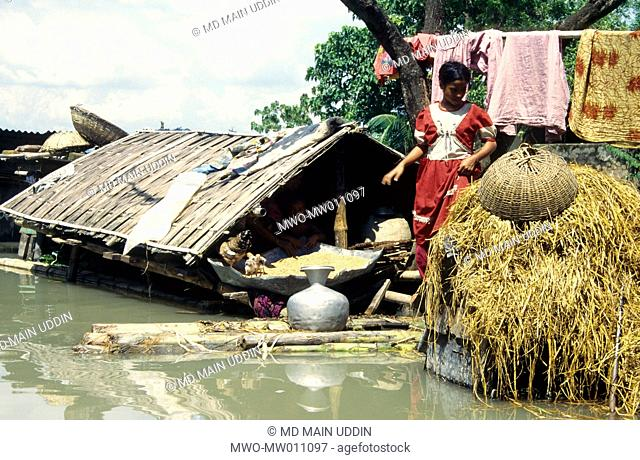 A rural girl floats on a banana raft to collect fresh water in the flood affected village of Singair, Bangladesh September 13, 1998
