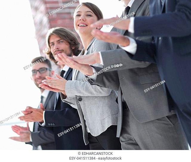 Business people hands applauding, standing in a row.photo with copy space