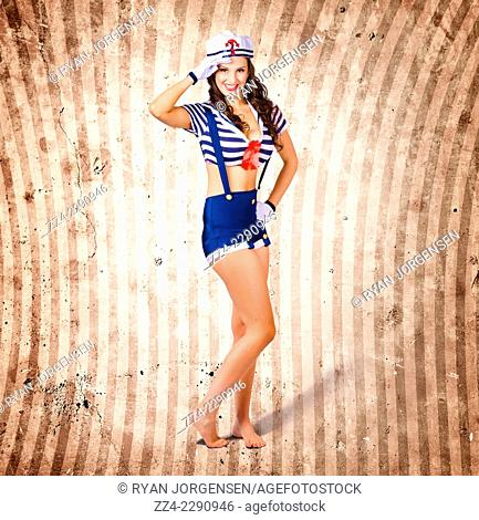 Gorgeous young retro pinup girl with curly brunette hair style and beautiful makeup wearing sailor uniform saluting in comic style portrait on grunge stripe...