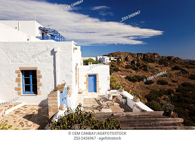 Whitewashed houses with balconies and terraces by the cliff at town center called Plaka, Milos, Cyclades Islands, Greek Islands, Greece, Europe