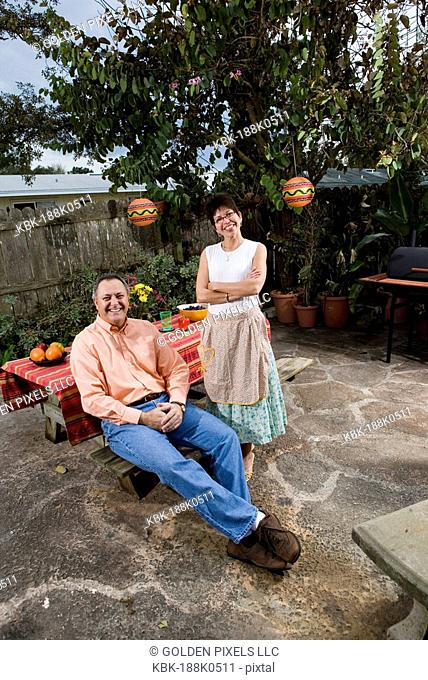 Portrait of a mature couple in front of a picnic table