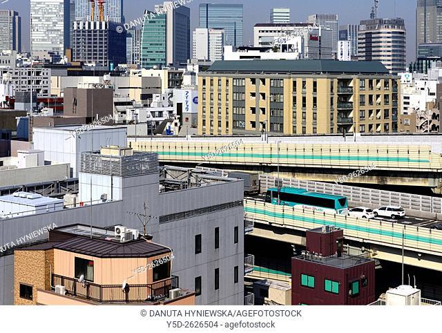 Urban landscape, Metropolitan Expressways number 6 and 9 seen inside jungle of buildings, Chuo, Chuo-ku, Central Ward, Tokyo, Japan