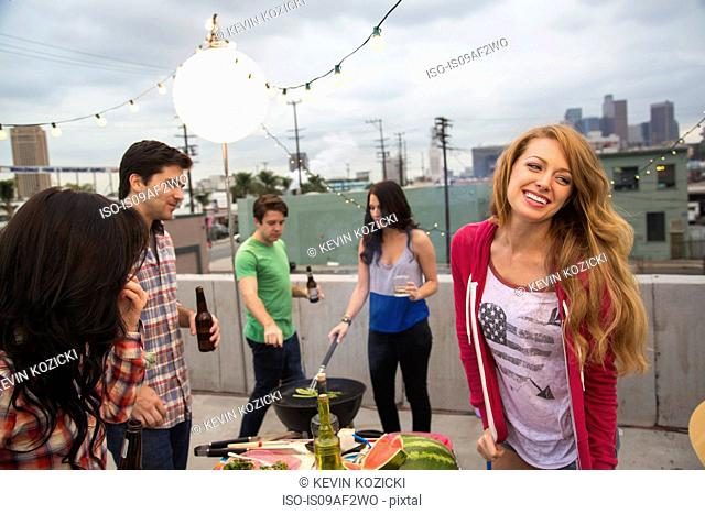 Young adult friends enjoying barbeque