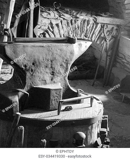 Black and White anvil dated 1865 with hammer and other tools