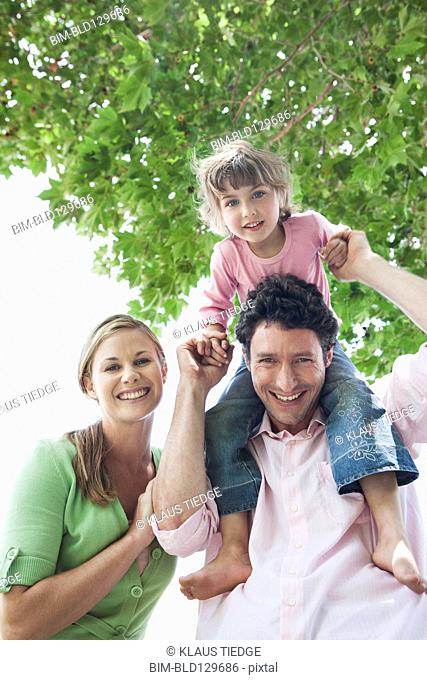 Caucasian family smiling outdoors